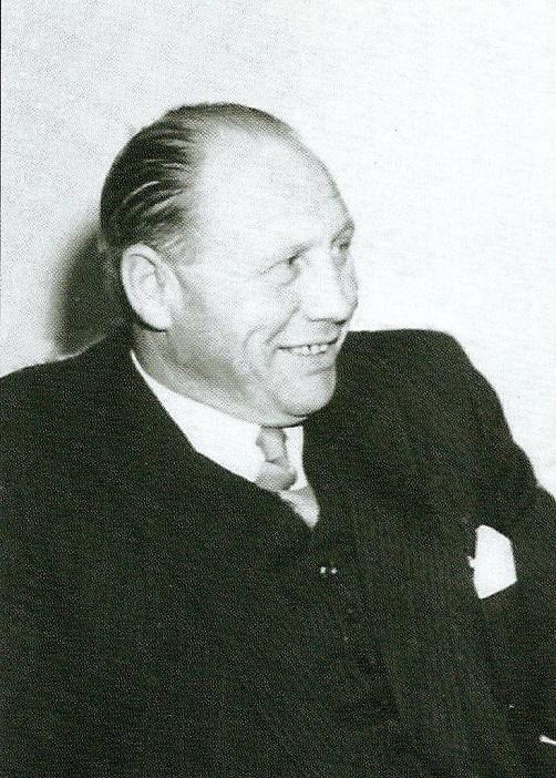 """Et billede af den ældre Chr. Jørgensen brugt af forlaget Motorploven i deres bog """"De autoriserede Nimbus-forhandlere""""."""