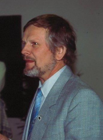 Niels Laustsen var formand, da AMK holdt  sin 60 års Jubilæumsreception på Restaurant Søsporten i 1990. Billedet er fra denne dag.